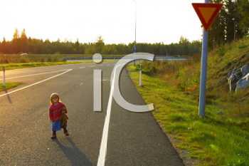Royalty Free Photo of a Little Girl on a Road