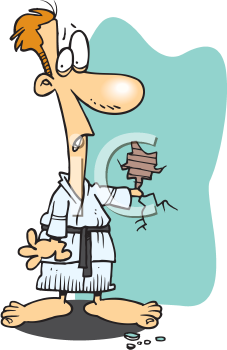 Royalty Free Clipart Image of a Man Doing Karate and Cracking the Wall