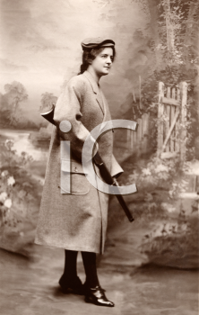 Royalty Free Photo of a Woman Carrying a Shotgun