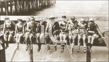 Royalty Free Photo of a Group of Youths Fishing from a Pier