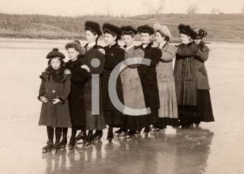 Royalty Free Photo of Women Skating on a Pond
