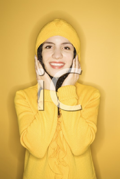Royalty Free Photo of a Woman Wearing a Yellow Raincoat Smiling