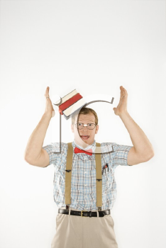 Royalty Free Photo of a Man Dressed Like a Nerd With Books Sliding off His Head