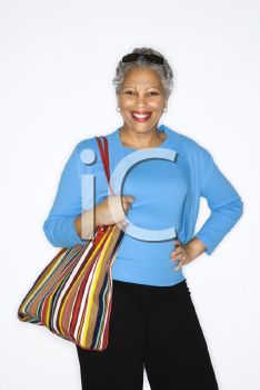 Royalty Free Photo of a Smiling Woman Holding a Purse