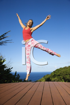 Royalty Free Photo of a Woman Jumping into the Air
