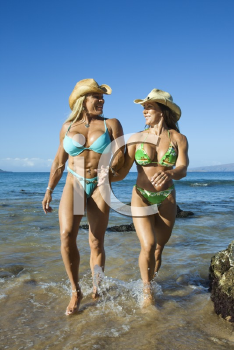 Royalty Free Photo of Female Bodybuilders in Bikinis Walking Through Water on Maui Beach
