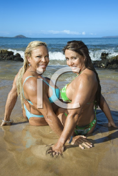 Royalty Free Photo of Female Bodybuilders in Bikinis Sitting in the Sand on Maui Beach