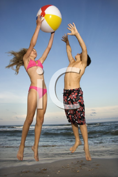Royalty Free Photo of Pre-teens Playing Beach Volleyball
