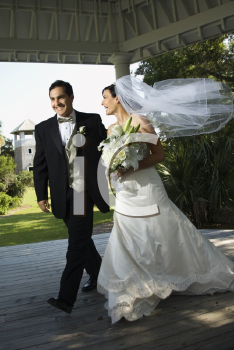 Royalty Free Photo of a Bride and Groom Walking Together