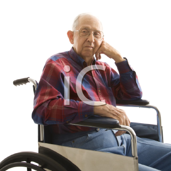 Royalty Free Photo of an Elderly Man Sitting in a Wheelchair Smiling