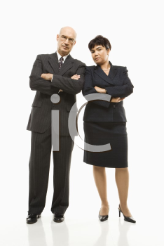 Royalty Free Photo of Smiling Businessman and Businesswoman Standing With Arms Crossed