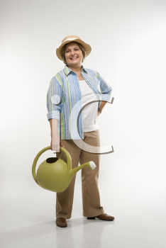 Royalty Free Photo of a Woman Holding a Watering Can