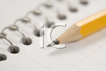 Royalty Free Photo of a Pencil on Top of a Spiral Bound Notebook