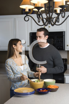 Royalty Free Photo of a Couple Making Salad at a Kitchen Counter