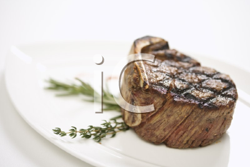 Royalty Free Photo of a Grilled Beef Tenderloin on a Plate
