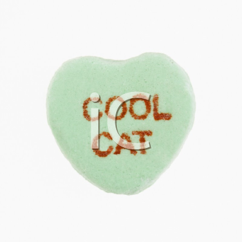 Royalty Free Photo of a Green Candy Heart That Reads Cool Cat