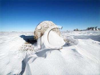 Royalty Free Photo of a Bale of Hay in the Snow