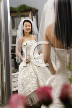 Royalty Free Photo of a Bride Admiring Herself in the Mirror