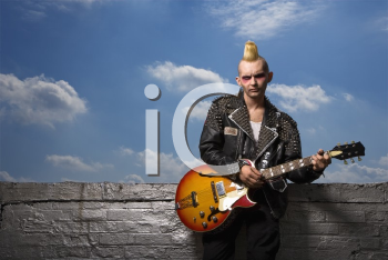 Royalty Free Photo of a Punk Holding a Guitar