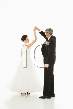 Royalty Free Photo of a Groom and Bride Dancing