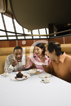 Royalty Free Photo of a Small Group of Friends Eating Dessert at a Restaurant