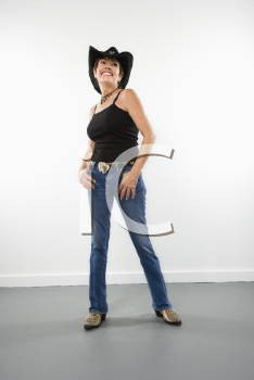 Royalty Free Photo of a Portrait of a Pretty Woman in a Cowboy Hat Smiling