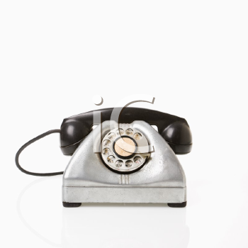 Rotary telephone with black receiver.