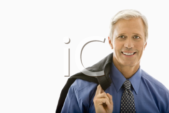Royalty Free Photo of a Businessman With His Jacket Draped Over His Shoulder