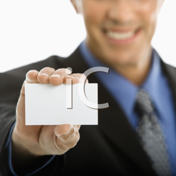 Royalty Free Photo of a Middle-aged Man Holding a Business Card Out