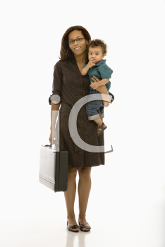 Royalty Free Photo of a Businesswoman Holding Her Toddler Son on Hip and Smiling