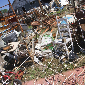Royalty Free Photo of a Chaotic Mess of Junk Strewn Across a Junkyard Outdoors