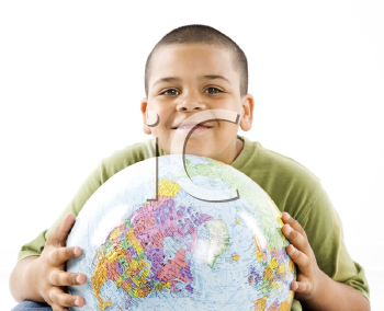 Royalty Free Photo of a Young Boy Holding a Globe