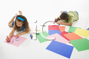 Royalty Free Photo of a Young Boy and Girl Coloring on Construction Paper and Smiling