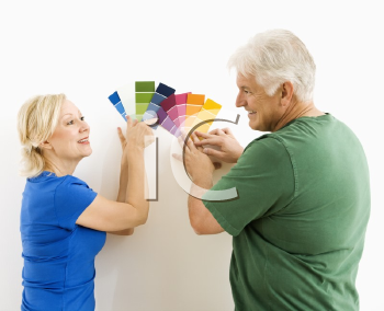 Royalty Free Photo of a Middle-Aged Couple Comparing and Discussing Paint Swatches