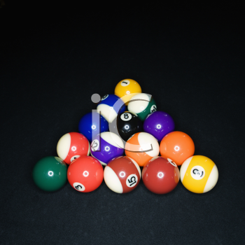 Pool tables arranged in triangle on pool table.