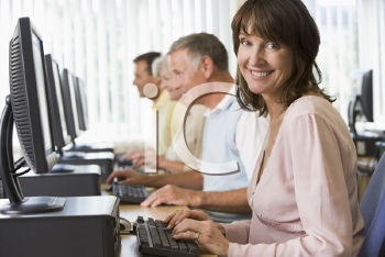 Royalty Free Photo of a Four People Sitting at Computers