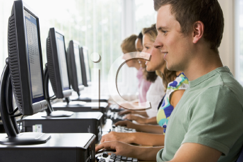 Royalty Free Photo of Students Sitting at a Computer