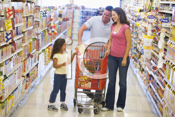 Royalty Free Photo of a Couple Shopping With Their Daughter
