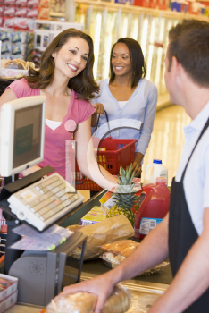 Royalty Free Photo of Woman At the Grocery Store Checkout