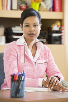Royalty Free Photo of a Teacher at Her Desk
