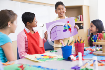 Royalty Free Photo of a Student Showing His Artwork