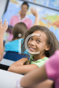 Royalty Free Photo of a Student Looking Backwards in Class