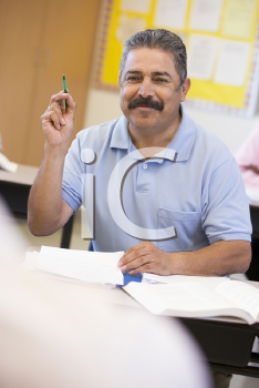 Royalty Free Photo of a Guy With a Pen