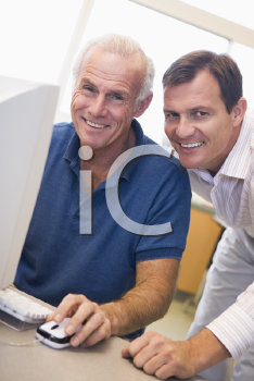 Royalty Free Photo of Two Men at a Computer