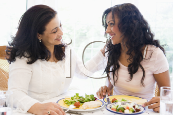 Royalty Free Photo of Two Women at a Dinner Table