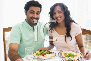 Royalty Free Photo of a Couple Eating Dinner