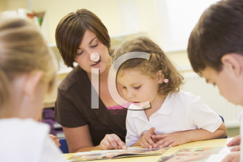 Royalty Free Photo of a Teacher and Students Reading