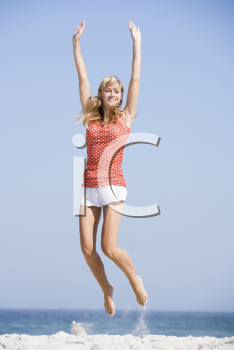 Royalty Free Photo of a Woman Jumping at the Beach