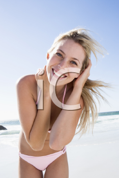 Royalty Free Photo of a Young Woman at the Beach
