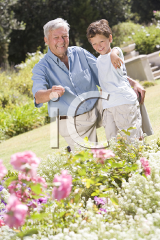 Royalty Free Photo of a Grandfather and Grandson in a Garden
